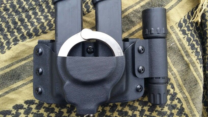 Double Magazine And Handcuff Holder Double magazine pouch WHandcuff pouch and flashlight holder 1