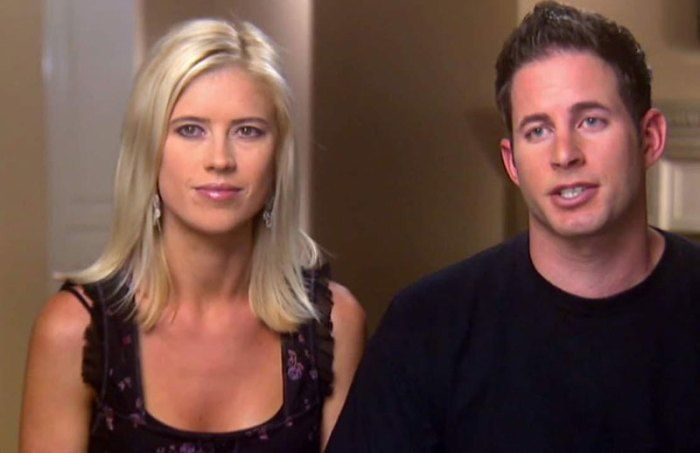 Christina El Moussa beams as she enjoys a hug from a mystery