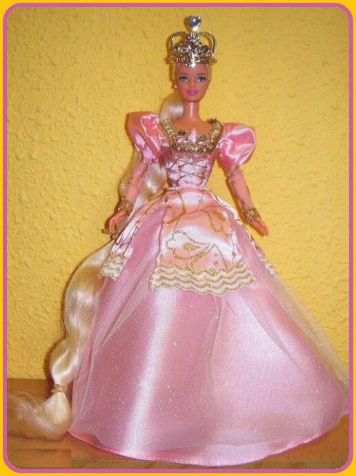 """#barbie #barbiecollector #barbiecollection  Barbie Rapunzel Doll in a pink gown with gold crown """"Let my hair down from my crown again and again!"""" Mattel, 1997"""