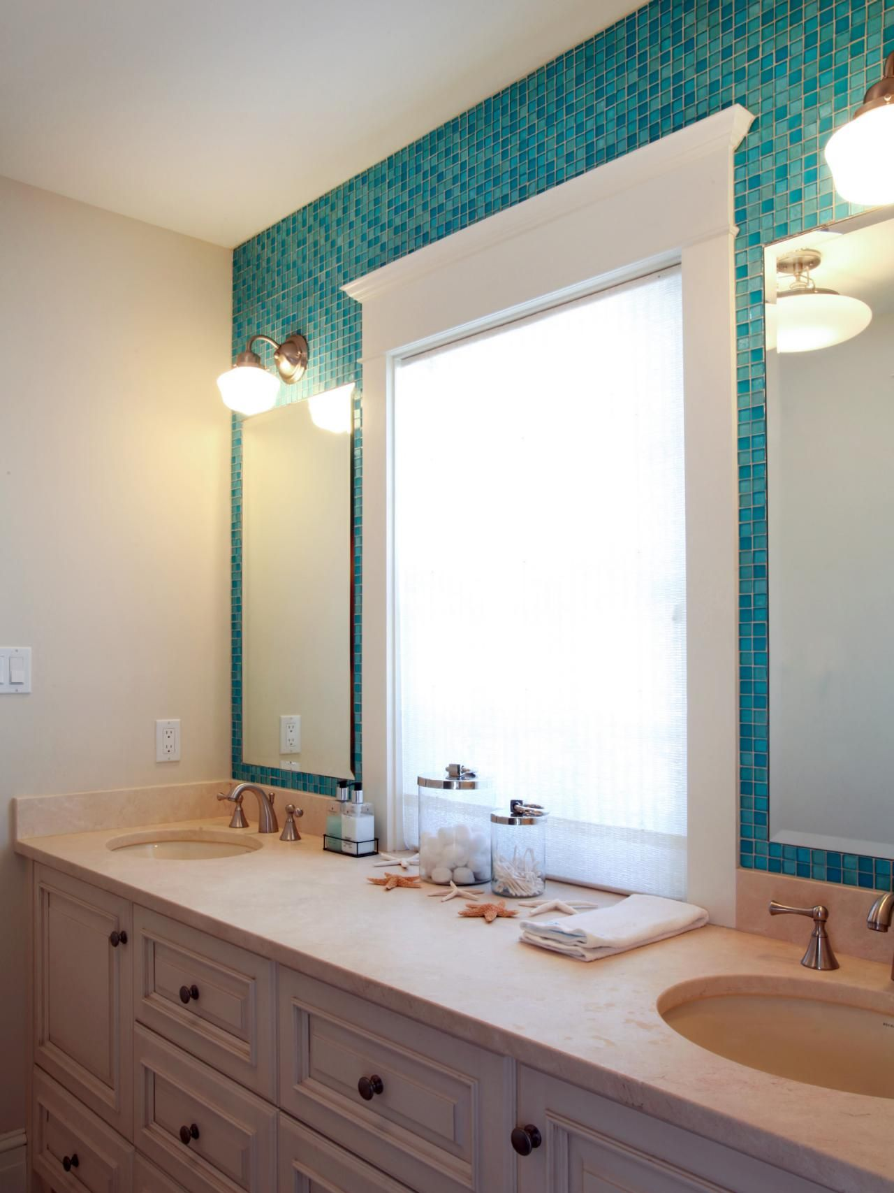 This Jack-and-Jill bathroom has a shimmering blue mosaic tile wall ...