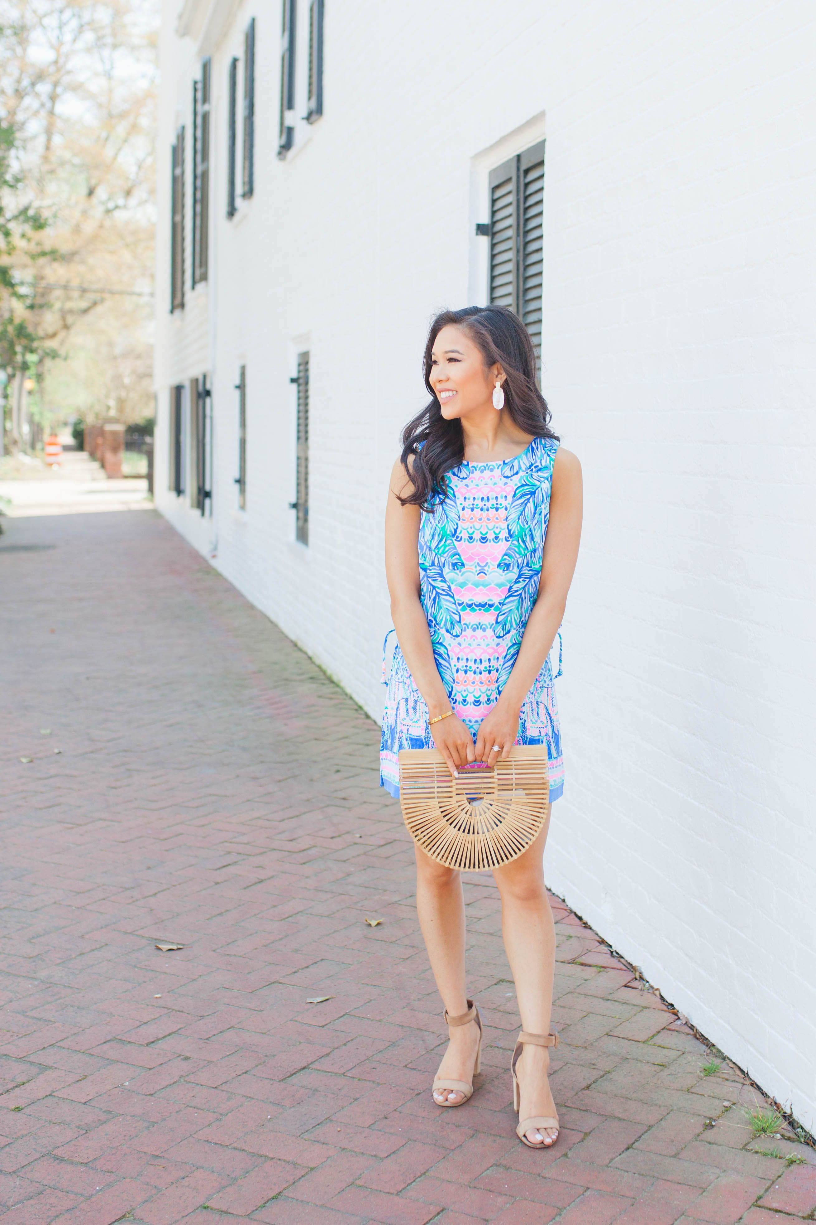 c7d6e1ca0f19 Lilly Pulitzer Donna Romper with Cult Gaia bamboo bag and Kendra Scott  earrings on blogger Hoang-Kim