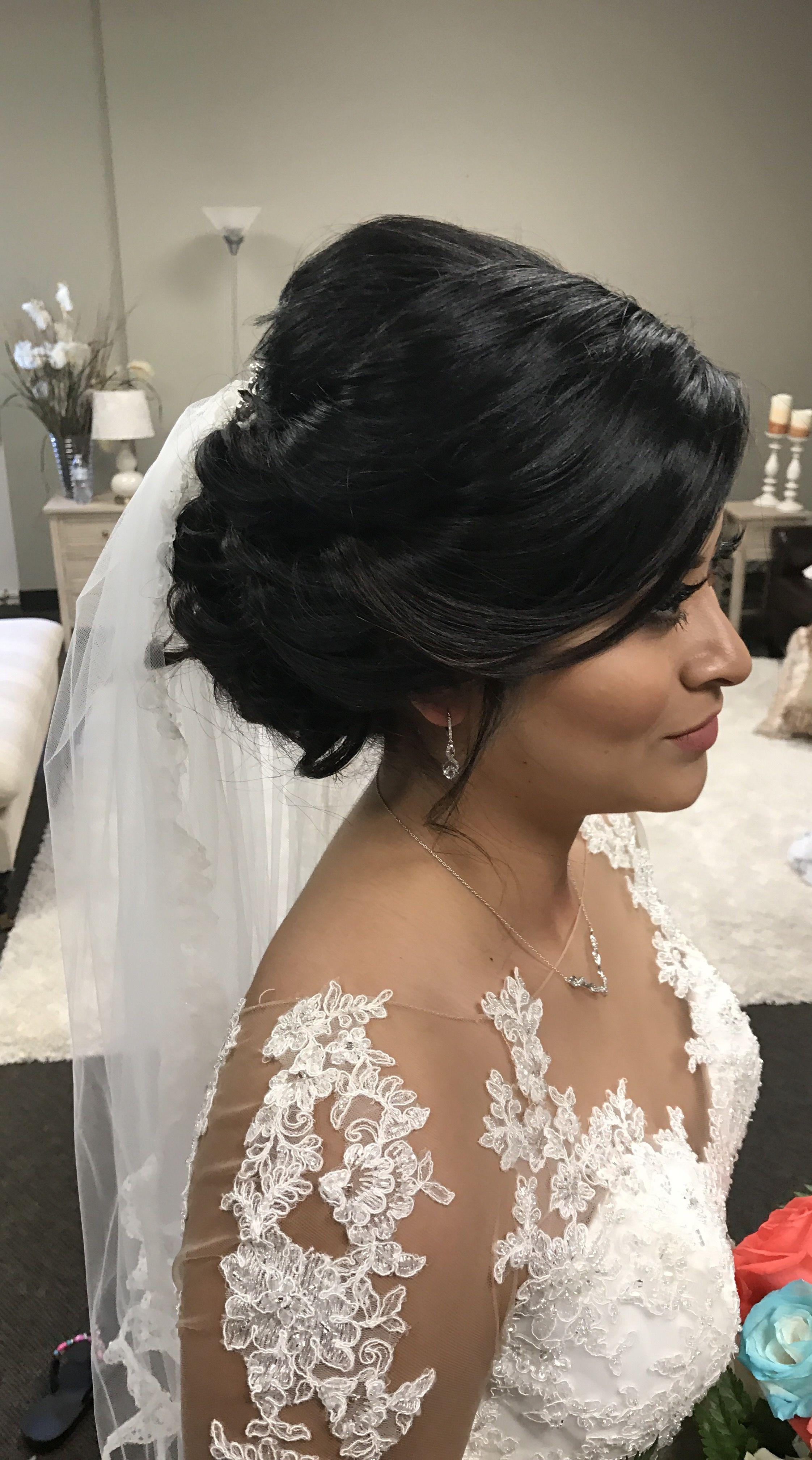 low wedding updo in bride! dark hair so beautiful