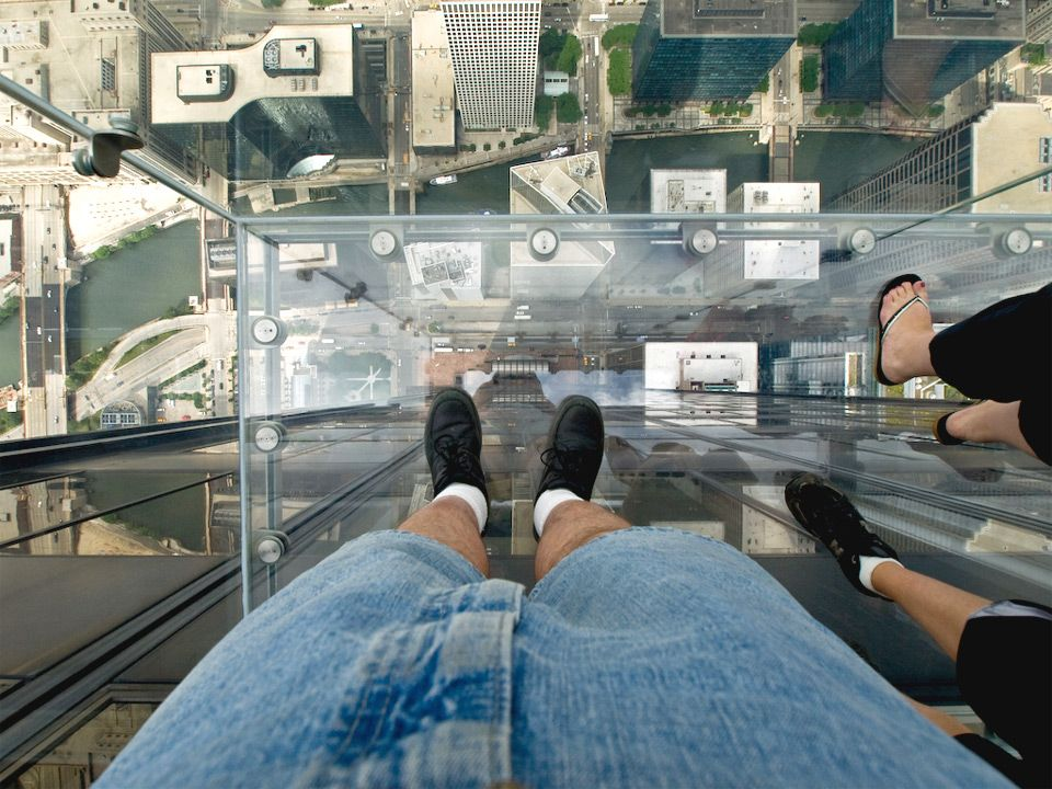 The skydeck of chicagos willis tower formerly the sears tower has added four glass bottomed balconies nicknamed the ledge which let tourists peer down