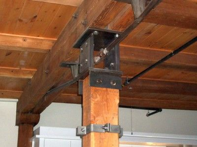 The existing heavy timber beams and columns in the Channel Center have steel column caps that are open in the middle to allow for steel tension rods to pass through them; a very cool industrial detail.