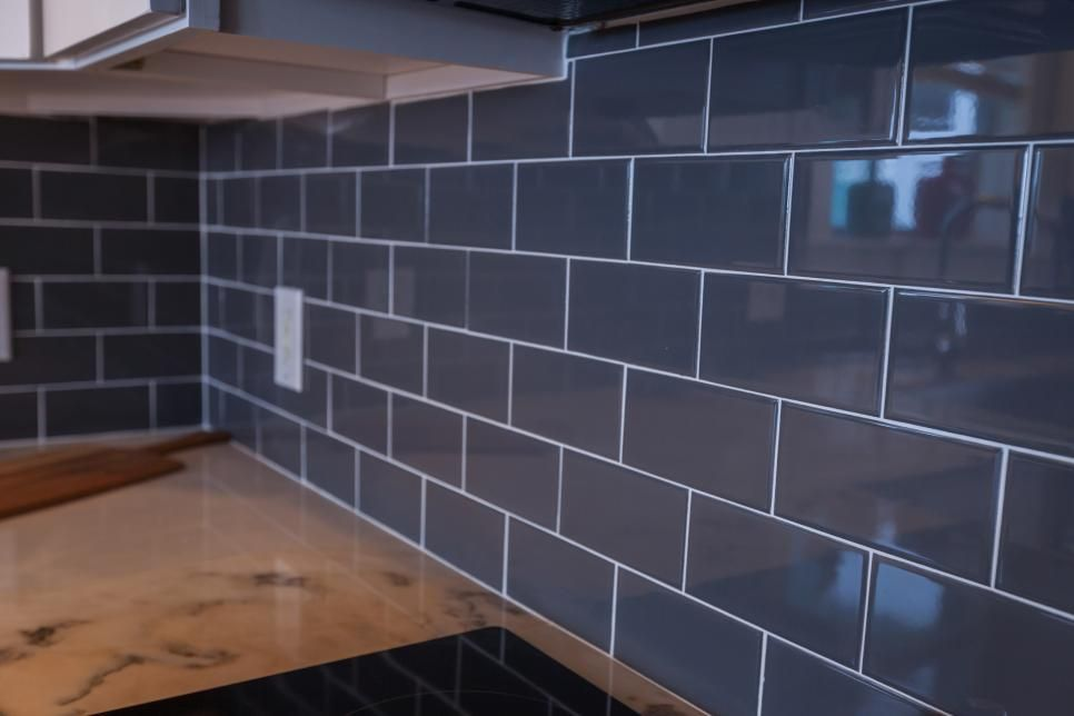 dark gray subway tile with white grout adds a neutral moody rh pinterest es
