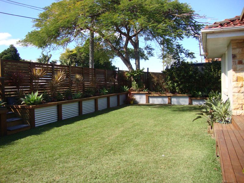 Low Corrugated Iron And Wood Retaining Wall Landscaping 400 x 300