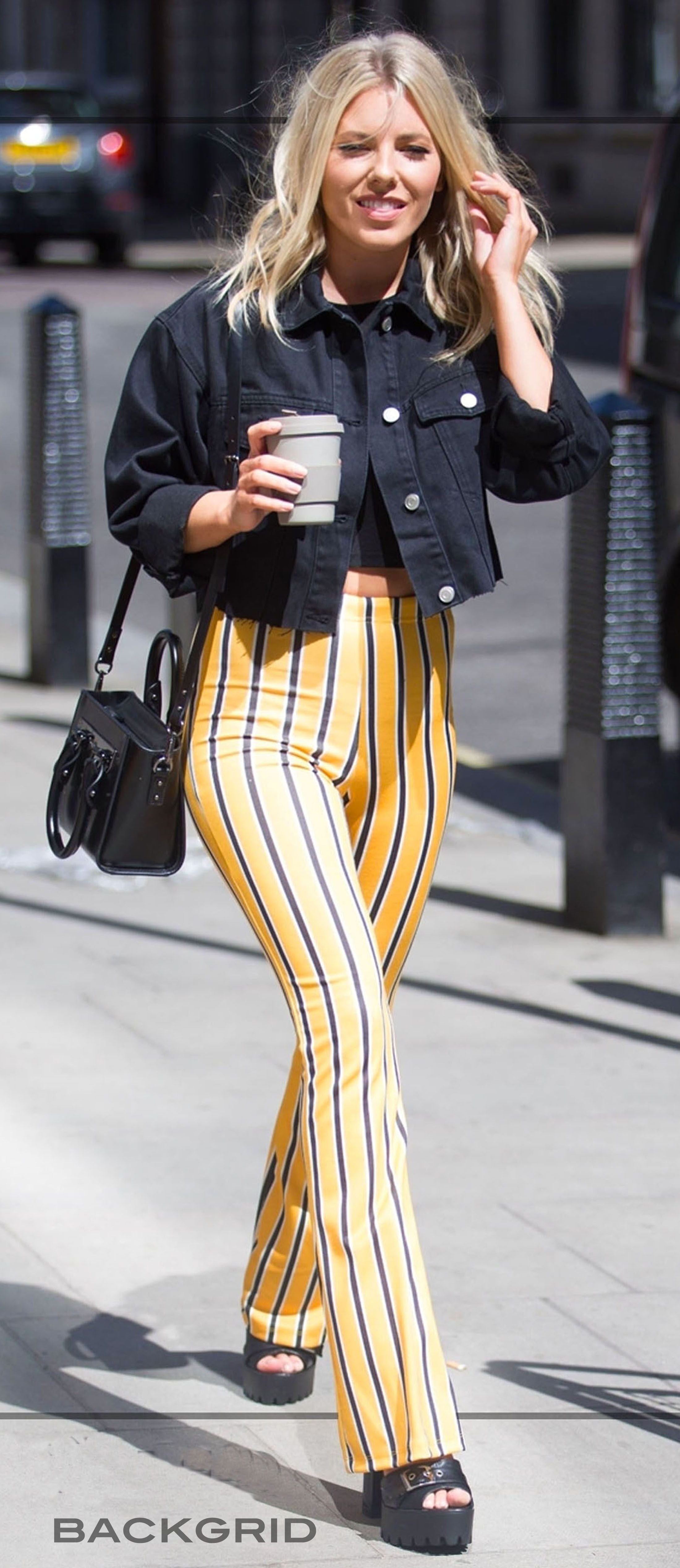 34c5b596def5 Mollie King wears a pair of yellow striped flare trousers by Topshop ...