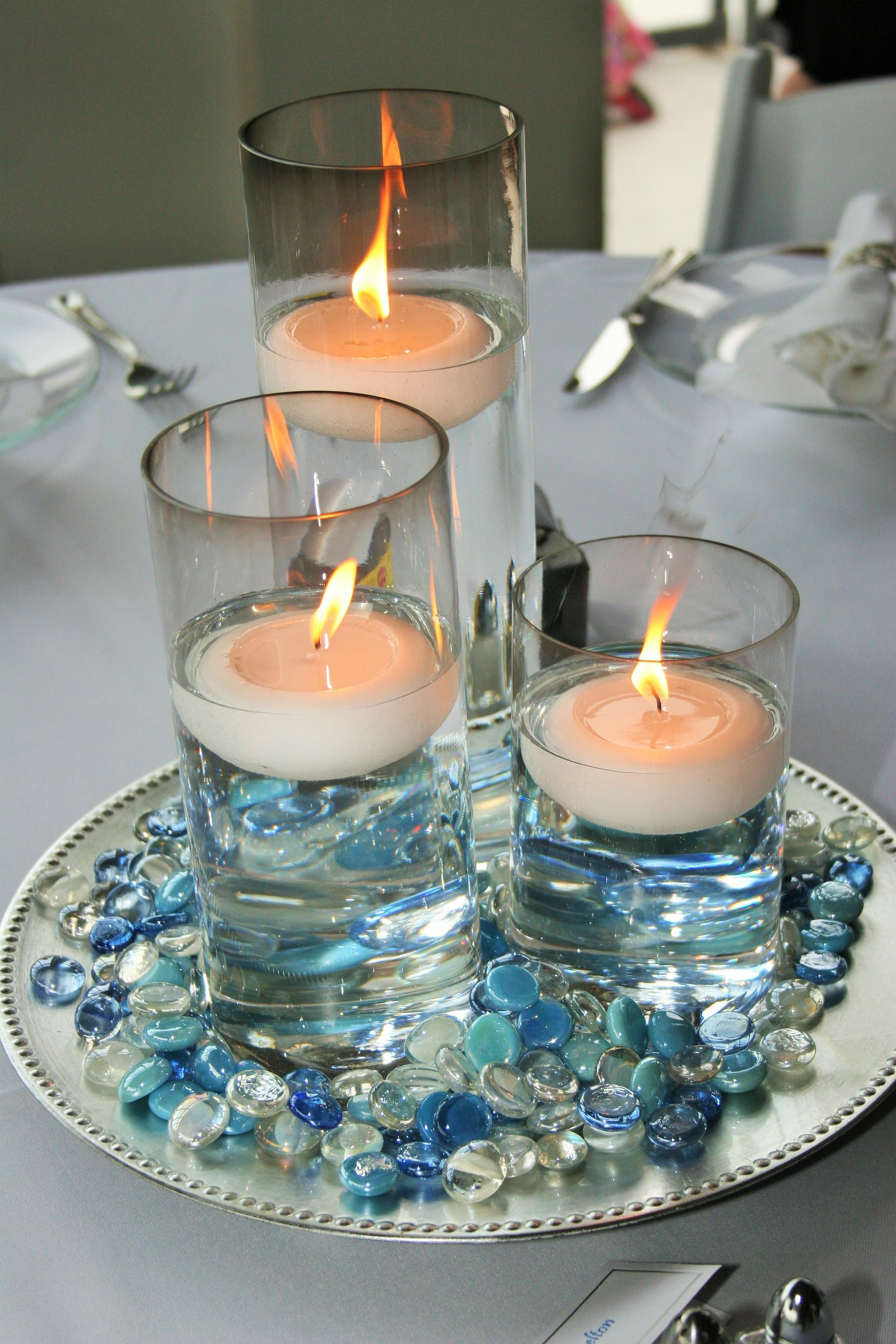 3 glass cylinder wedding centerpiece with floating candles 3 glass cylinder wedding centerpiece with floating candles surrounded by blue and clear glass gems floridaeventfo Gallery