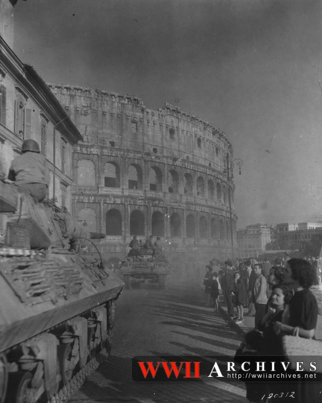 American vehicles of the Fifth Army pass the ancient Coliseum as they begin to occupy Rome.  Rome, Italy.  June 5, 1944.