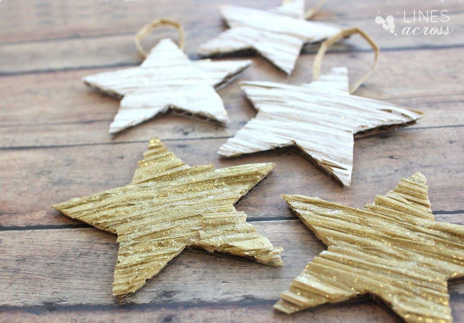 I love making quick and easy ornaments to help decorate the tree. My kids and I love stars, so I thought I'd make a handful of textured stars in white and glittery gold for the tree. What you need: 1. Cardboard and Scissors 2. Paint and Paint Brush 3. Hot Glue Gun 4. Kraft Ribbon What you do: 1. Cut out a bunch of stars from a piece of cardboard.