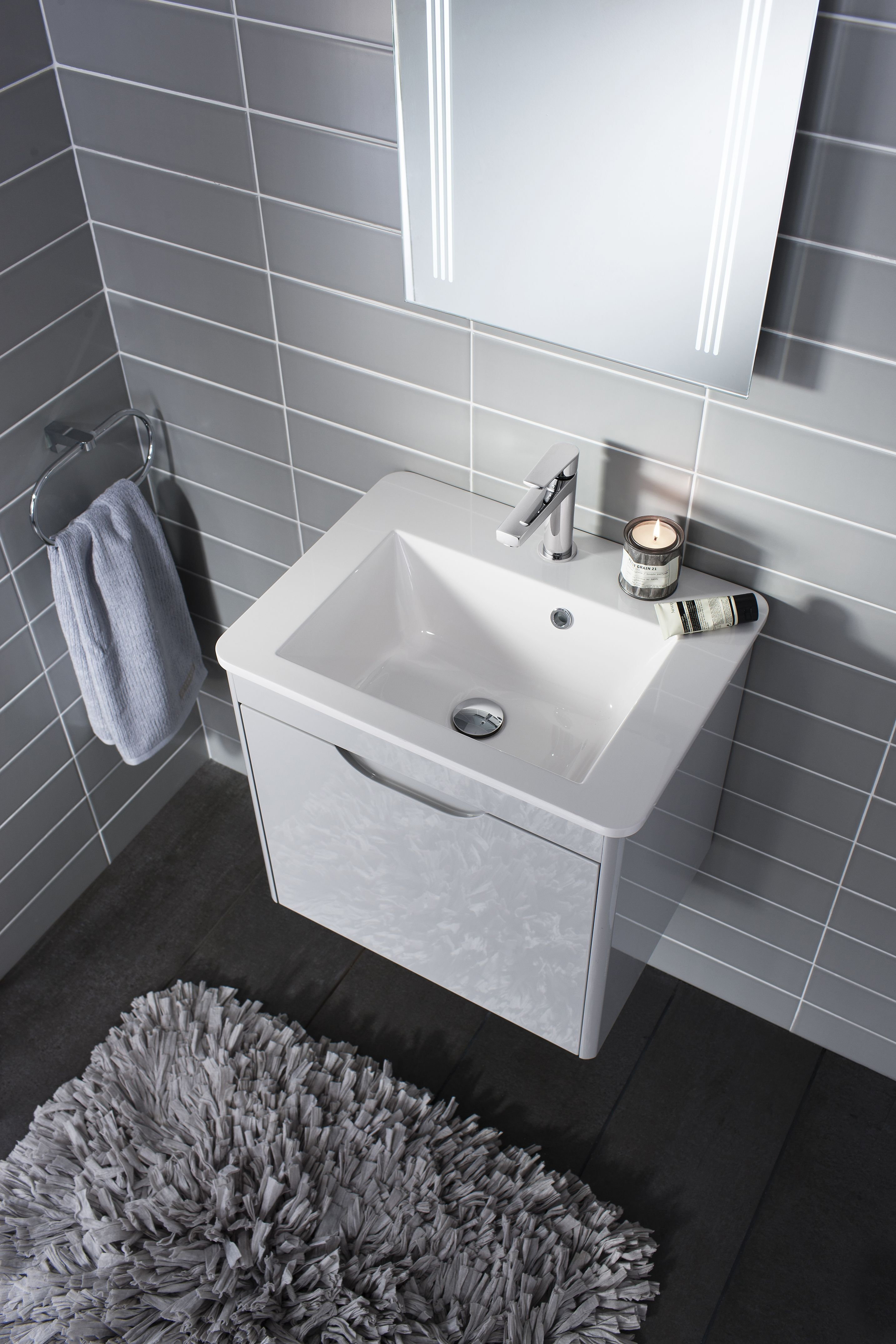 A high-gloss, soft grey finish blends perfectly with white bathroom ...