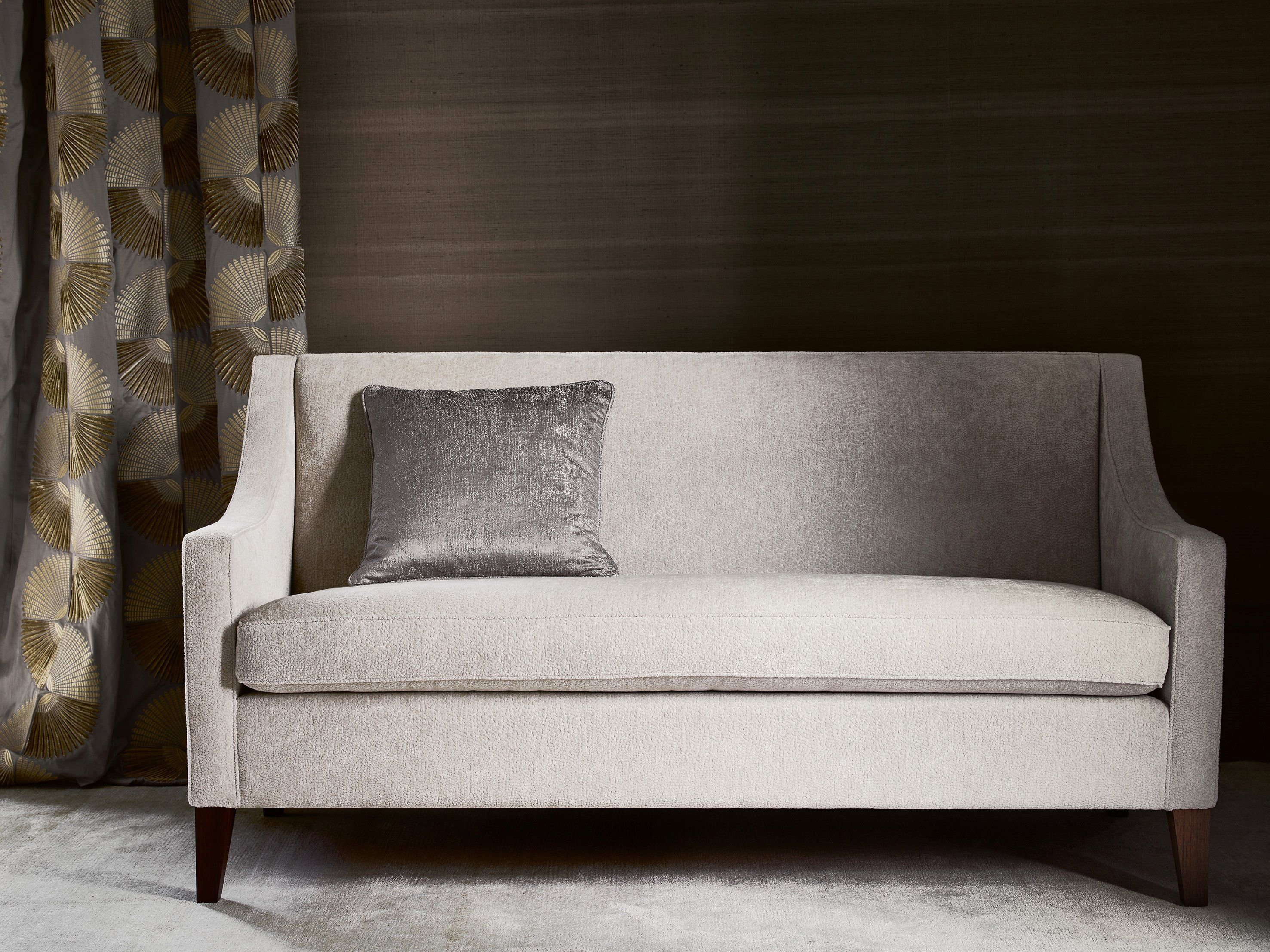 Sofa in Foxtrot ivory and cushion in Indra silver by Jane