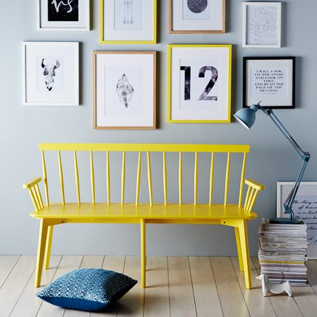 I have a bench like this but it's brown. Never thought of painting it yellow! Love it next to the grey. Cool!