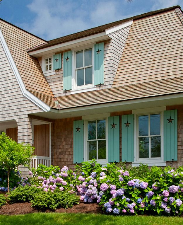 A shingled house with aqua shutters on cape cod for Cape cod exterior
