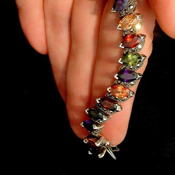 A Sultry High End Vintage Sterling Silver #GemstoneBracelet embellished with Luscious Prong-set Multi-color Genuine Gemstones, Hidden Locking Push Closure, and