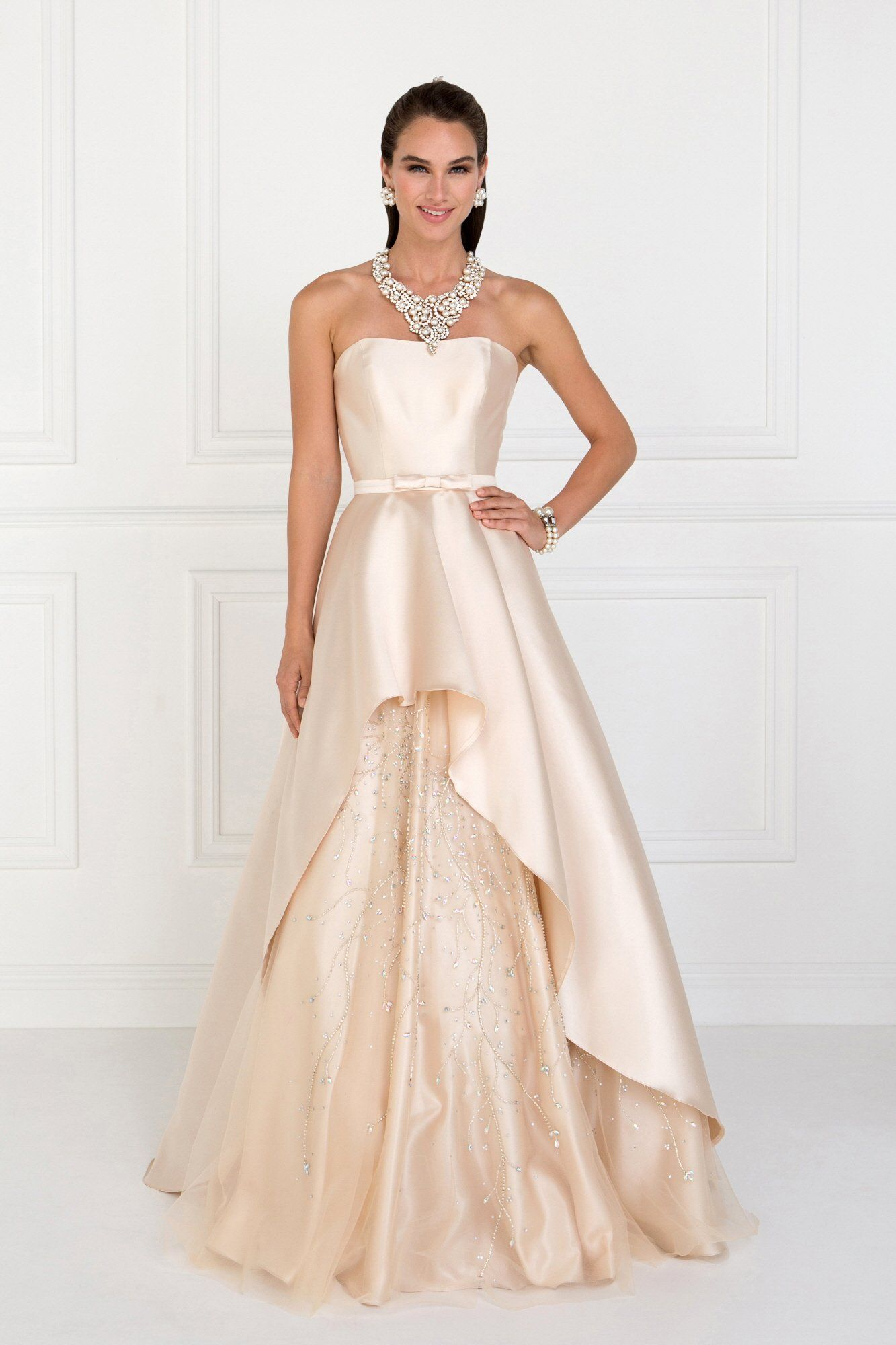 d7fd793d420 Wear this beautiful champagne evening gown and be the belle of the ball. A  strapless ball gown adorn with dazzling beading.