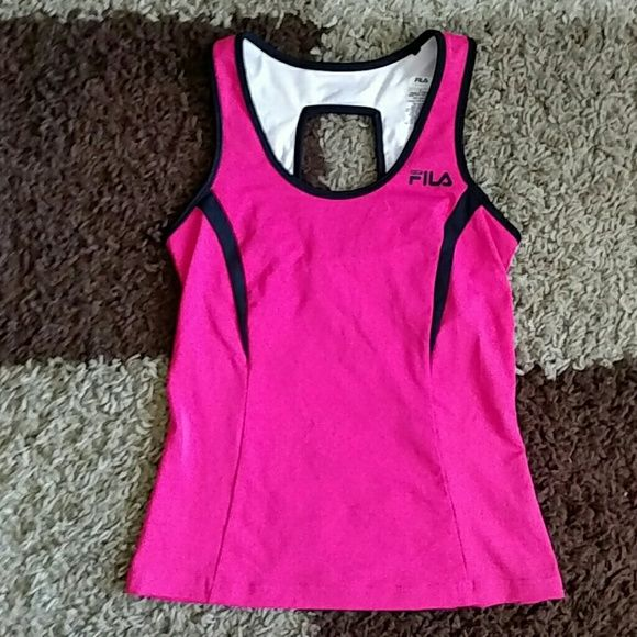 NWOT Fila sport workout tank S Brand new, never worn, bright pink workout tank top by Fila sport in a size small. Has built in sports bra, cute cut out feature in back and media/key pocket on lower back on top. Fila Tops Tank Tops