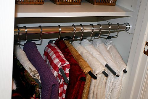 Neat idea for storing table cloths and extra throws.
