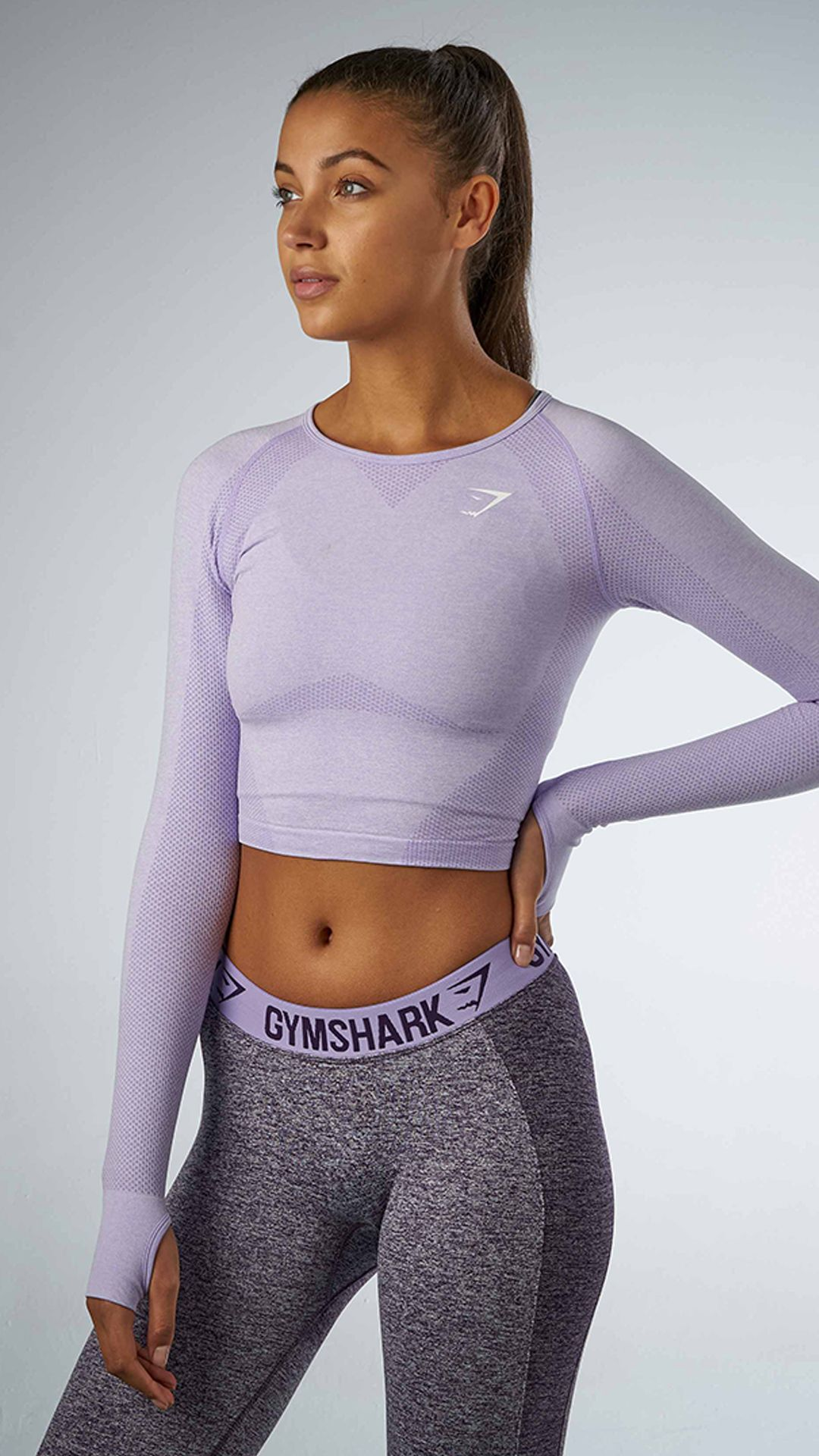 3ed90e348ff The most comfortable long sleeve crop top for your workout with a classic  seamless knit.