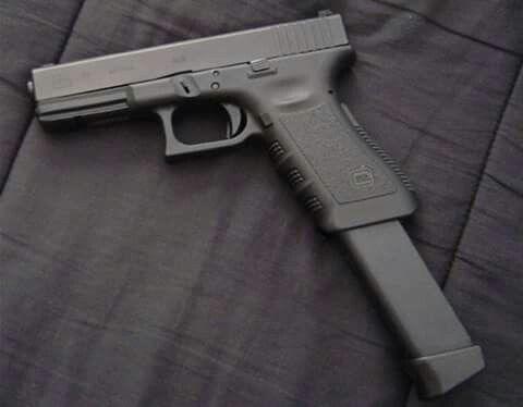 Glock 9 with extended clip Find our speedloader now! http ...  Glock 9 with ex...