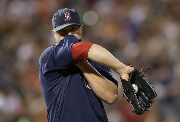 Boston Red Sox Starting Pitcher Jon Lester Wipes Sweat From His Face Between Pitches During The Second Inning Of A Base Red Sox Baseball Boston Red Sox Red Sox