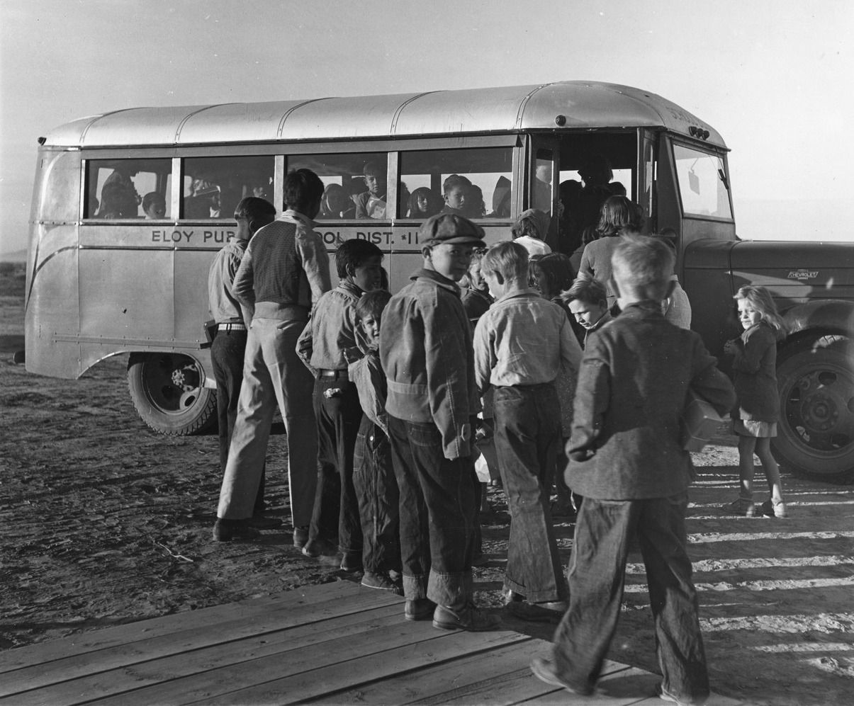 Bus picking up migratory cotton pickers children to the