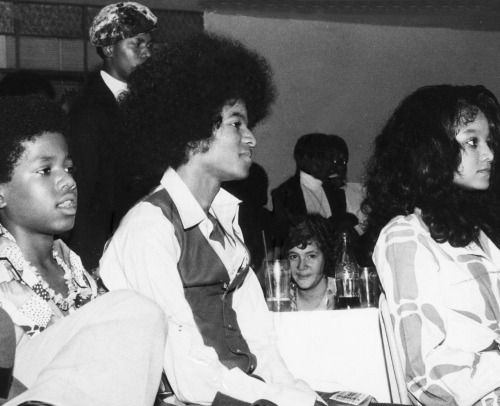 Jamaica  1975.  Randy Jackson, Michael Jackson and Latoya Jackson watch the performances at a ball held in their honour at the Sheraton during their visit to the island.