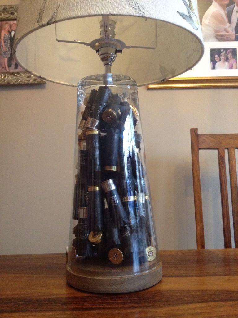 Shotgun cartridge filled table lamp