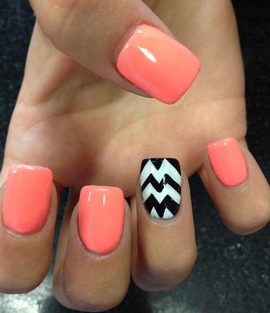nail art: bright orange and chevron.