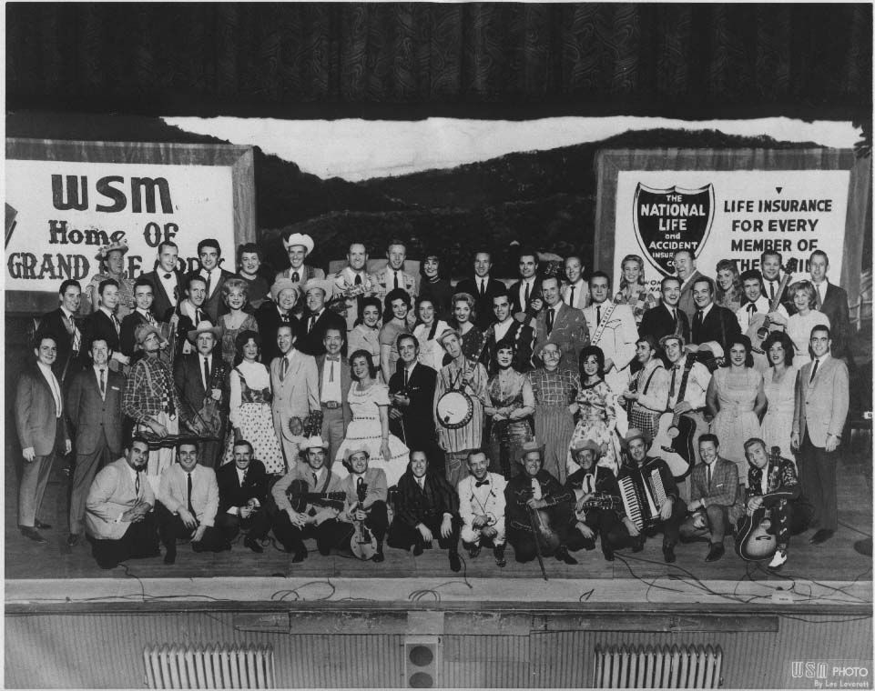 Grand ole opry cast on the stage of the ryman auditorium