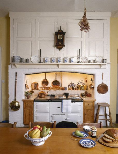Cupboards and shelf above the range cooker hanging pots and a kitchen photos watchthetrailerfo