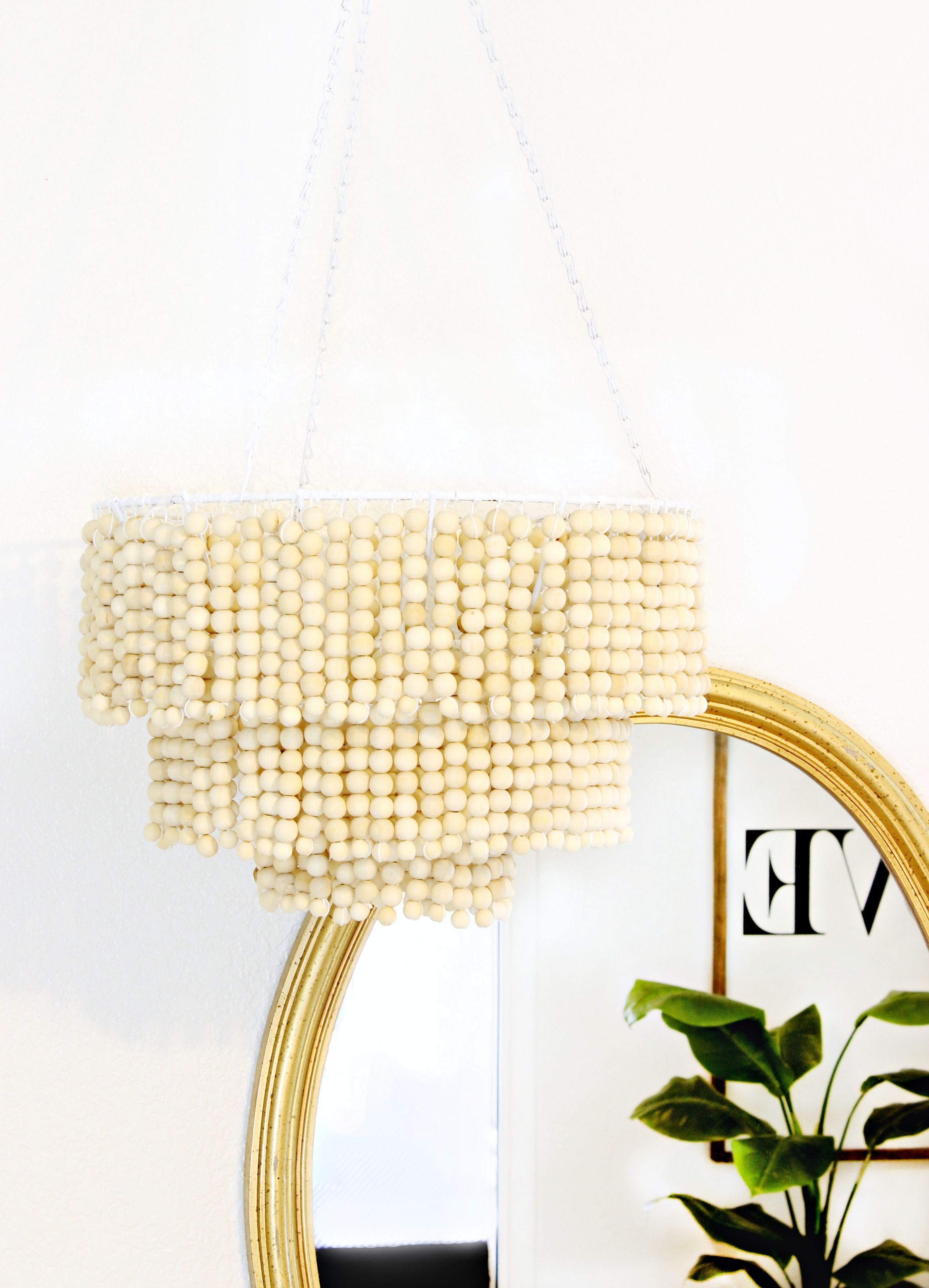 Love this DIY Wood Bead Chandelier for tutorial