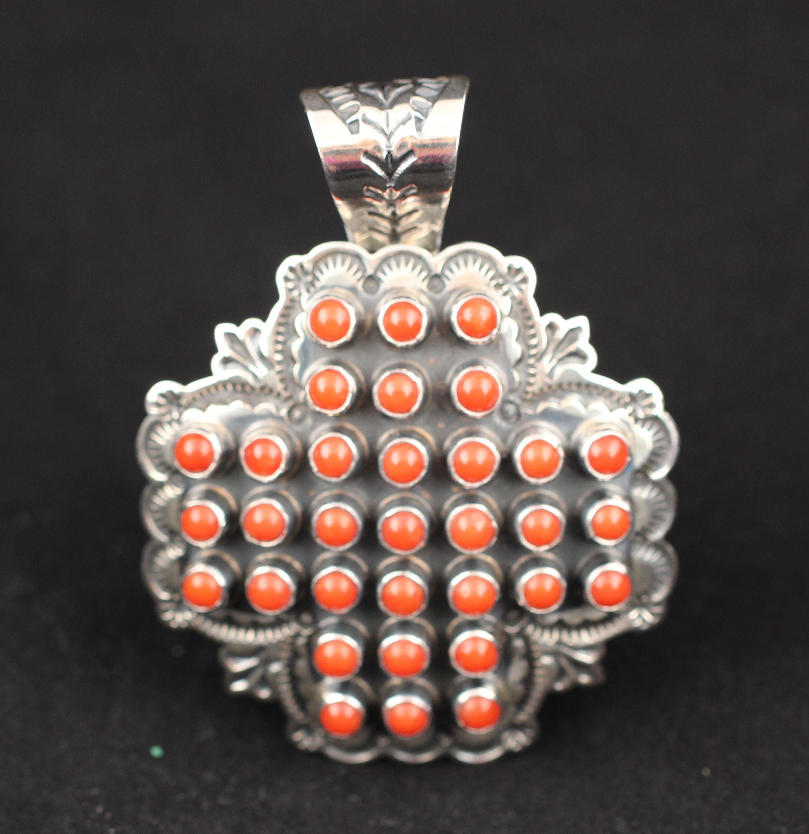 Sunshine Reeves Pendant.   #nativeamericanjewelry    #coraljewelry http://www.leotasindianart.com/