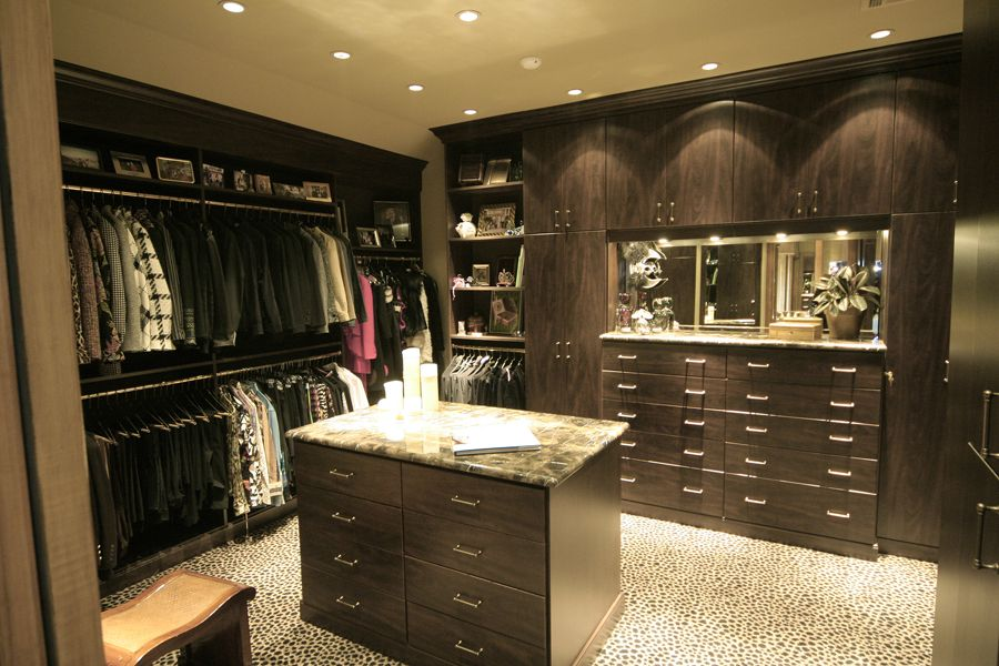 The lighting and colors in this closet make it a true dressing room. Start and end your days right with a closet designed to your needs. | Ultimate Closet Systems | Custom Closets | Closet Organization | Closet Dream | Closet Design | Closet Storage | Closet Remodel | Master Closet