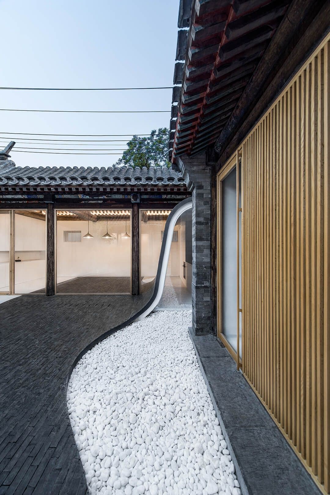 Traditional chinese house interior arch studio gives a literal twist to a traditional chinese typology