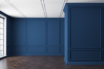 Empty blue room with a window