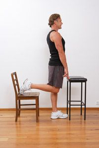 Standing Quad Stretch Place A Chair Approximately 0 5 Of A Metre Behind Yourself Face Away From The Chair Keeping Your Pelv Quad Stretch Pelvic Floor Pelvis