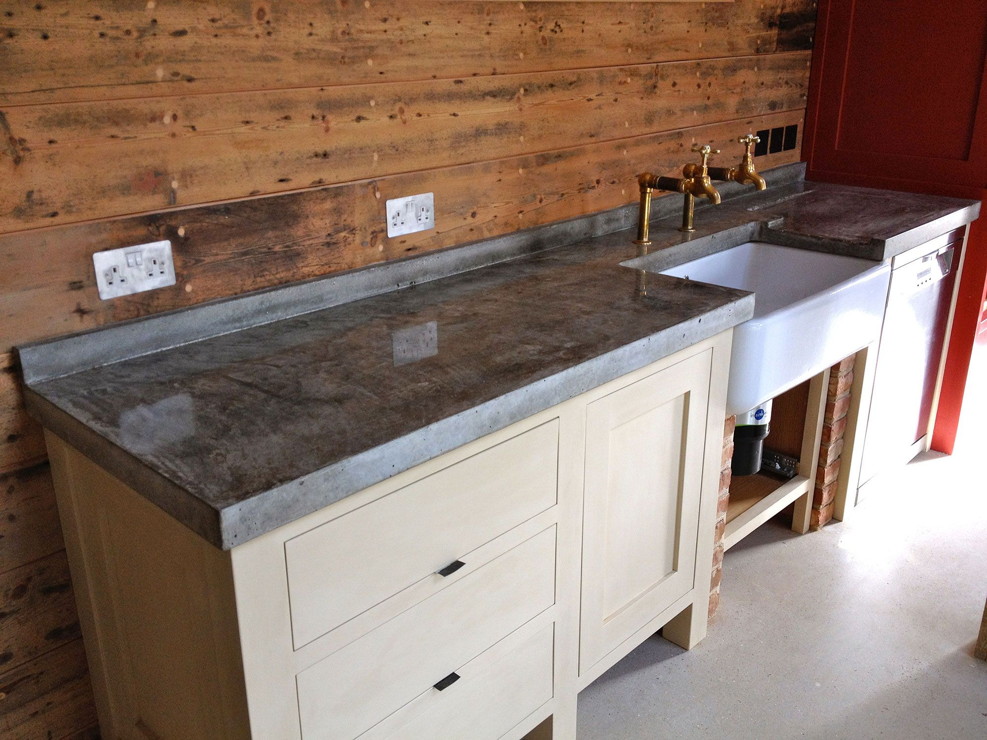 Rustic Kitchen With Wooden Backsplash And Concrete Countertop With ...
