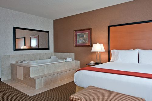 Holiday Inn Express Hotel Suites Calgary Hotels Jacuzzi And Fireplace 236 Hotel Suites Home Decor Home
