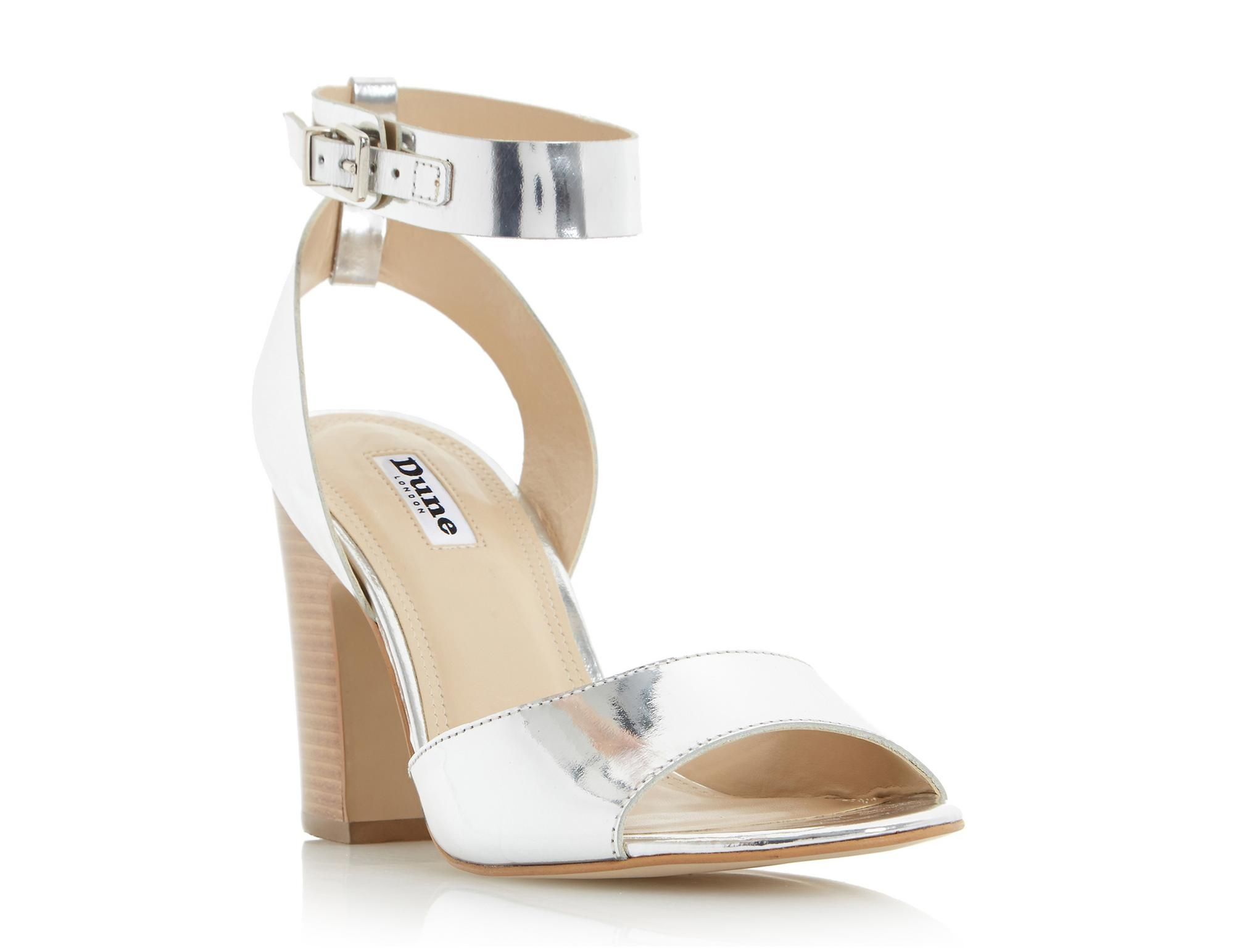 This demure two part ankle strap sandal is stylish yet sturdy. It features a mid block heel, ankle strap buckle fastening and an open toe. Work the tomboy look by styling it with dungarees and a striped jersey top.