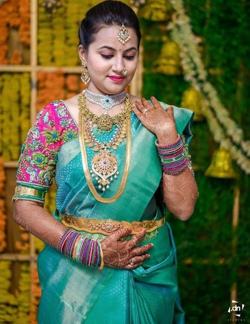 Bride in Mango and Kasu Mala Indian jewelry Blouse designs and Saree