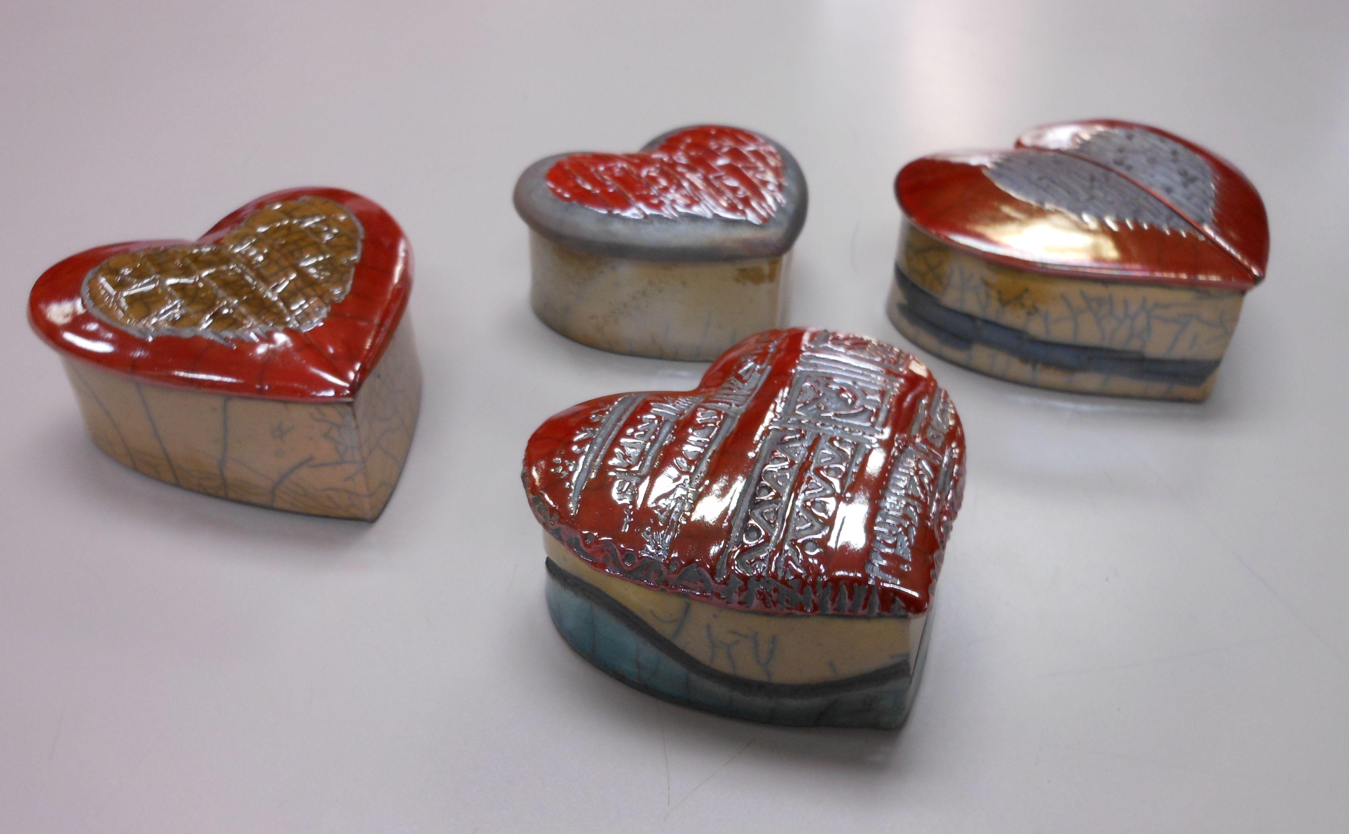 Tall raku pottery hanging hearts by Kelly Edwards
