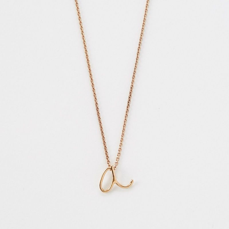 Give your fall outfit a personal touch with a handwritten initial necklace.