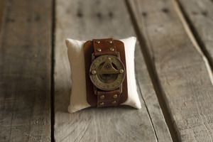 Sundial/compass wristwatch handcrafted in the jungles of Maui