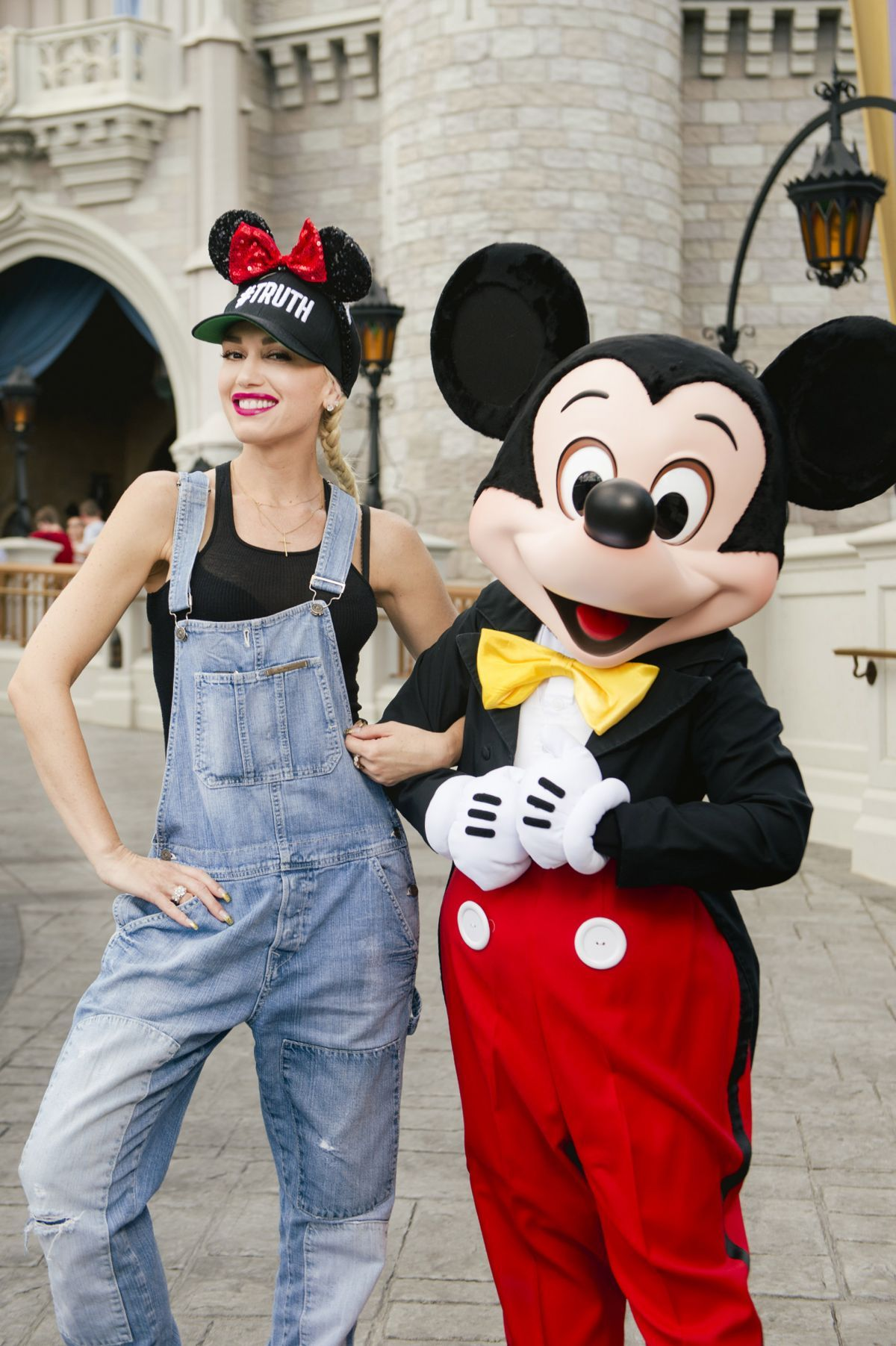 dailyactress:    Gwen Stefani and Mickey Mouse at Magic Kingdom Park in Lake Buena Vista 07/25/2016