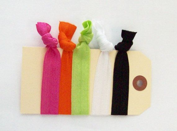 elastic hair ties neon hots hair accessories set by gillionmillion, $5.00  |  This listing is for 5 elastic hair ties. The colors are neon orange, neon green, white hot, black and hot pink. | The elastic is gentle to your hair and will not leave a crimp. Both adults and children can use these pretty ties. | **The ends are heat sealed to resist fraying.** | Ready to ship the next business day. | Colors may appear slightly different on different screens.