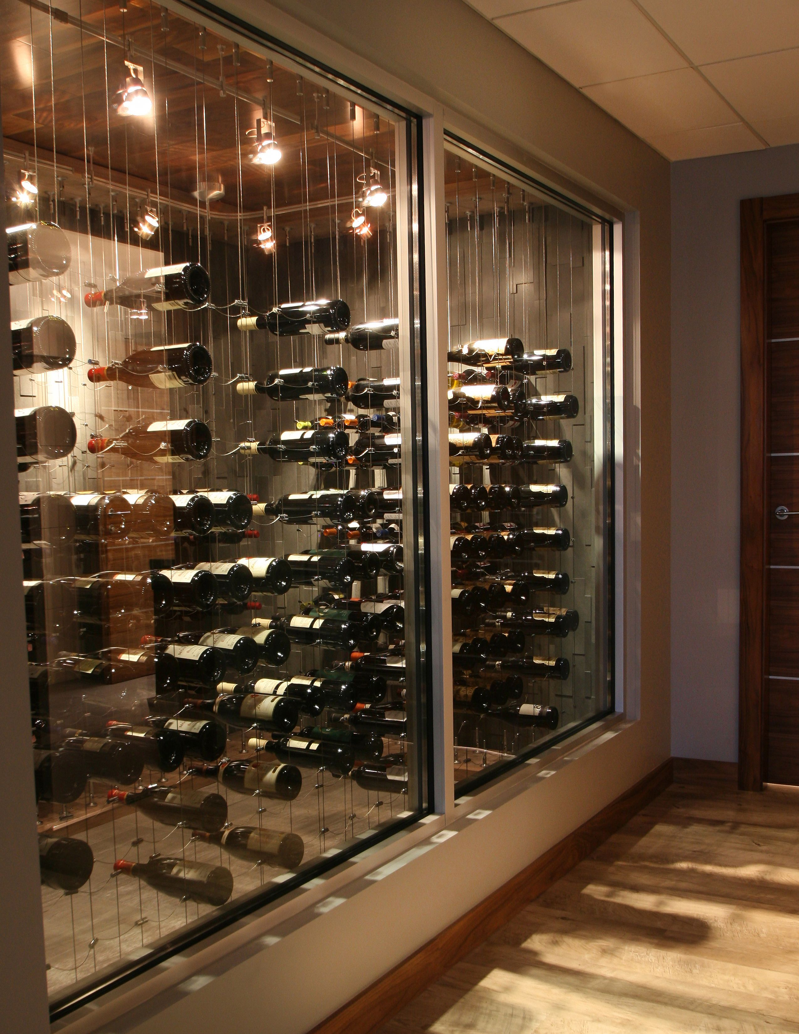 Hallway View Of Glass Enclosed Cable Wine System Custom Wine Cellar Wine Cellar Design Home Wine Cellars Wine Cellar Racks