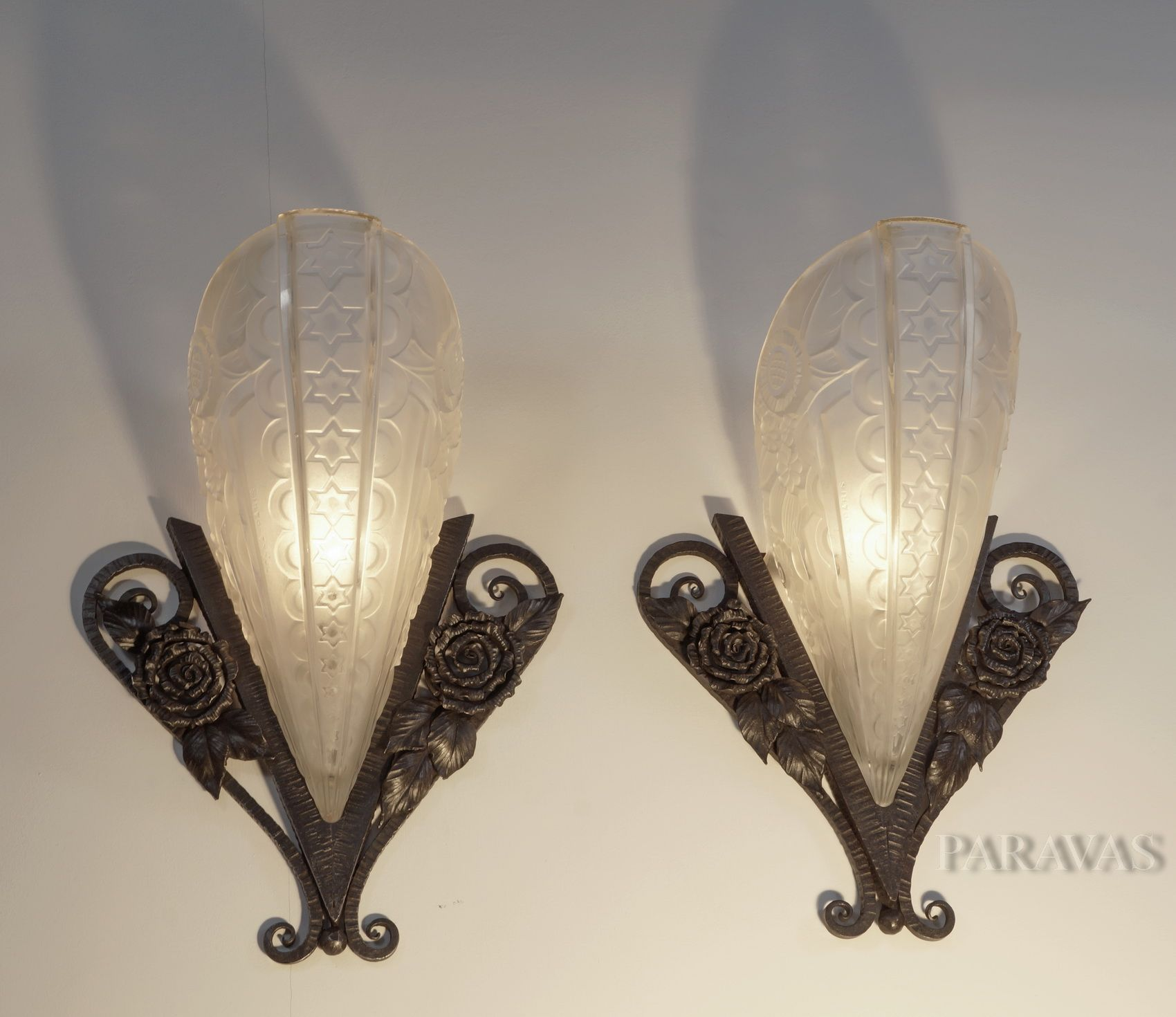 DONNA A pair of French art deco wall sconces in wrought iron