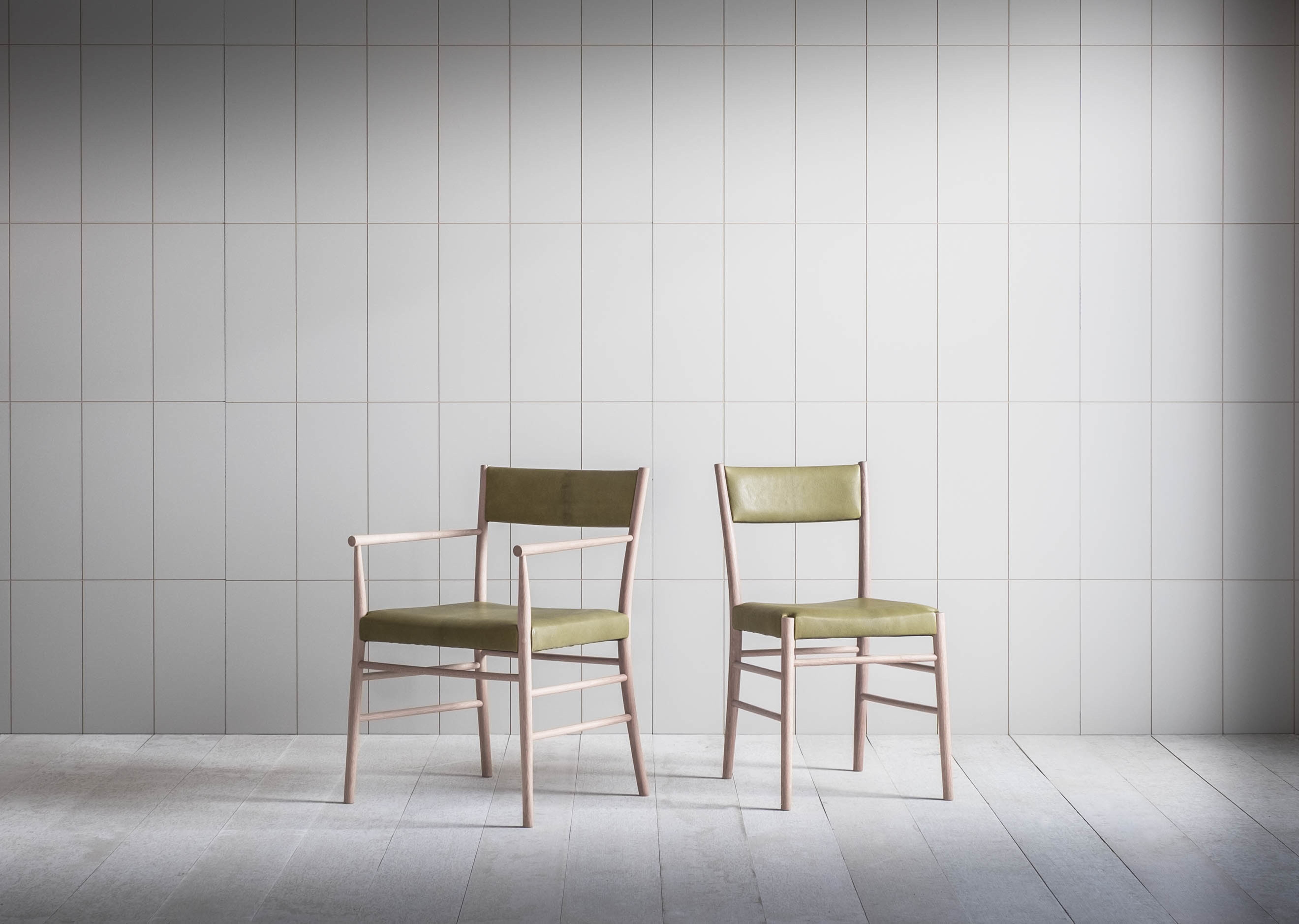 Upholstered Avery dining chair and armchair in olive leather and oak