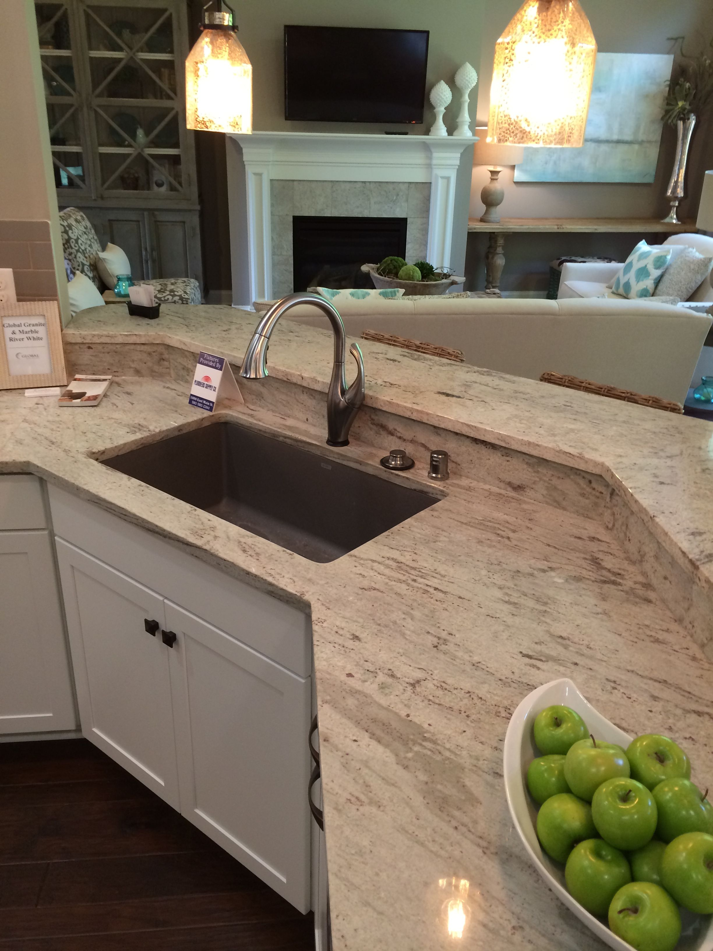 River White Polished Granite With White Cabinets Visit